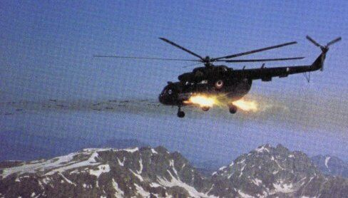 A Mi-17 fires 57 mm rockets during the initial strikes